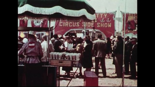 UNITED STATES 1950s : Spectators take part in side shows while waiting for entry into the circus tent.
