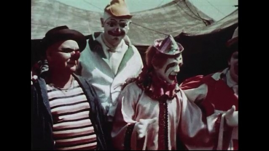 UNITED STATES 1950s : Clowns congregate as they prepare for a circus show.