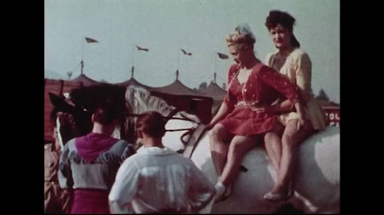 UNITED STATES 1950s : Two female performers sit on a horse as they prepare for the circus show.