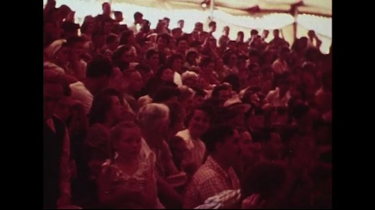 UNITED STATES 1950s : A crowd claps as circus performers are introduced and enter the stage.