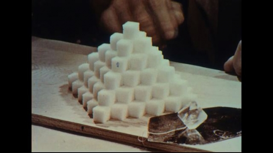 UNITED STATES 1950s: Close up, sugar cubes demonstrate crystal structure.