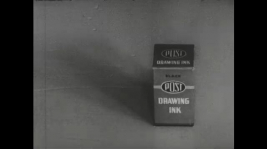 UNITED STATES: 1960s: hand opens box of Post drawing ink. Hand removes lid of ink