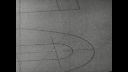 UNITED STATES: 1960s: hands use compass to draw half circle. Pencil points to compass marks.