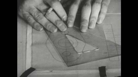 UNITED STATES: 1960s: hand moves plastic triangle over drawing.