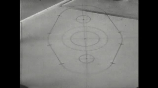 UNITED STATES: 1960s: hand draws circle in ink with compass.