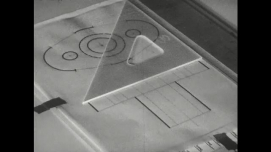 UNITED STATES: 1960s: hand connects two lines on tracing paper.