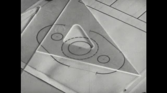 UNITED STATES: 1960s: hand draws circles with compass on tracing paper