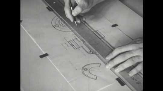 UNITED STATES: 1960s: pencil points to measurements on ruler edge.