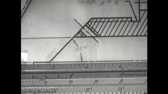 UNITED STATES: 1960s: hand draws ink marks on paper with ruler. Pencil points to line chart