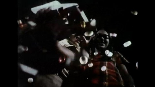 UNITED STATES 1970s: Extreme low angle of boy and girl, boy pours Lego pieces from box, dissolve to pills falling.