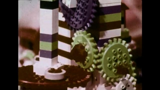 UNITED STATES 1970s: Close up views of Lego structure moving.