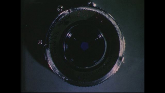 UNITED STATES 1950s: Close up of camera lens, iris opens and closes / Illustration of human eye, iris opens and closes.
