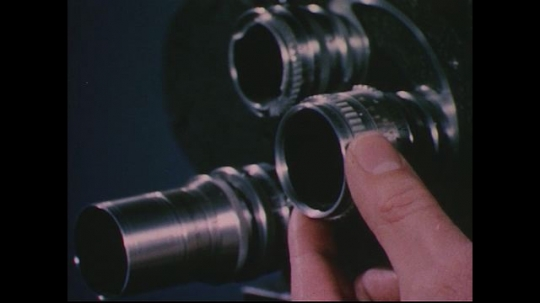 UNITED STATES 1950s: Close up, hand focuses lenses / Hand focuses camera lens / Animation of lens in eye focusing.