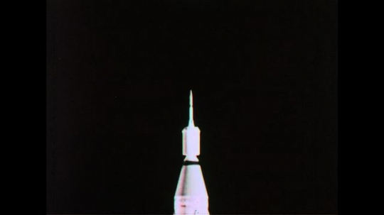 UNITED STATES 1960s: A rocket, controlled by a computer, takes off into space.