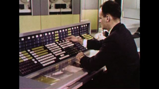 UNITED STATES 1960s: A man presses keys of a computer.