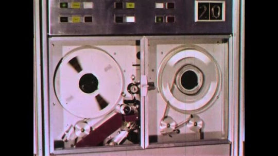 UNITED STATES 1960s: Spinning disks of a hard drive storing data.