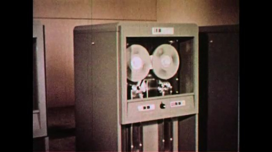 UNITED STATES 1960s: Information from punched card is recorded into films of tape.