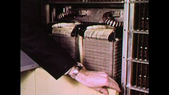 UNITED STATES 1960s: Stacks of magnetic core memory form a unit that can accommodate 65 thousand characters of information