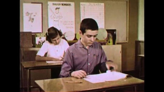 UNITED STATES 1960s: Students answer exams using a pencil to mark scantron papers.