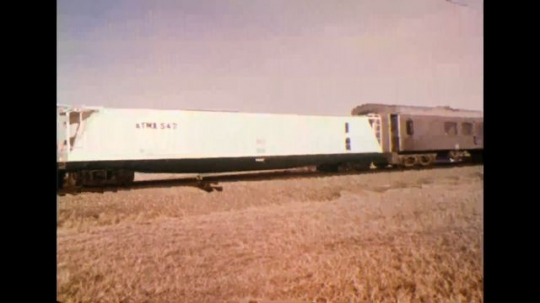 UNITED STATES 1970s - Train moving along tracks; interior of truck cab; man getting into truck cab with rifle.