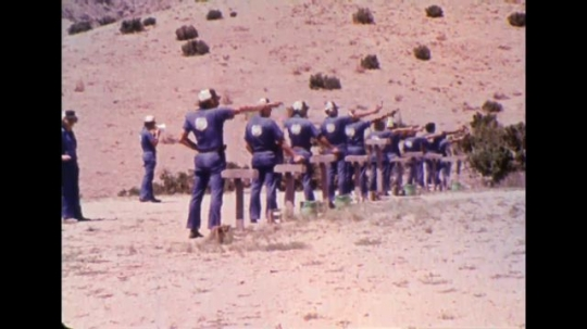 UNITED STATES 1970s - Government employees at a firing range.