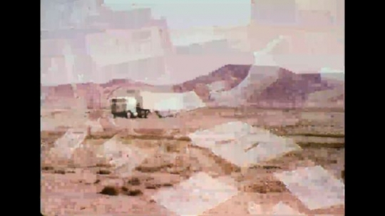 UNITED STATES 1970s - Truck driving through desert; driver's pov shot; control panel in truck cab.