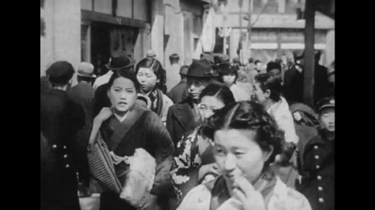 JAPAN: 1943: Japanese people walk the streets of Tokyo in traditional and modern outfits.
