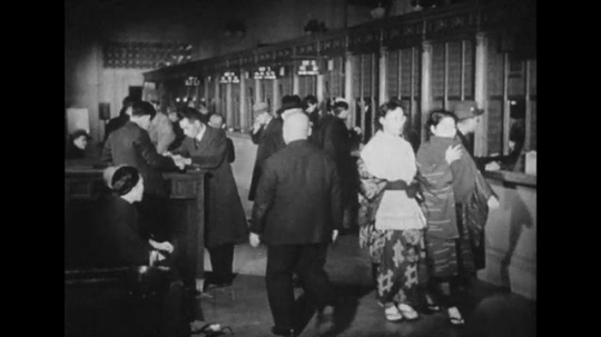 JAPAN: 1943: Two Japanese men bow to each other repeatedly as a form of greeting.