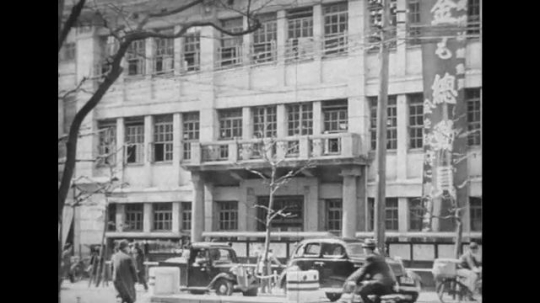 JAPAN: 1943: In a building, a Japanese reports write stories.