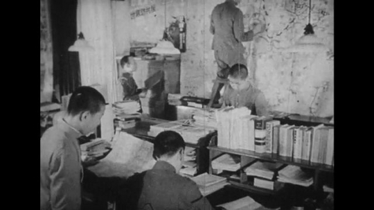 JAPAN: 1943: Japanese army checking news articles before they are printed.