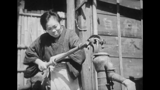 JAPAN: 1943: Families working hard in the rural areas of Japan to do their activities of daily living.