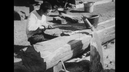 JAPAN: 1943: Japanese cutting wood and washing clothes.