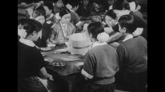 JAPAN: 1943: Japanese women eating in a cafeteria.