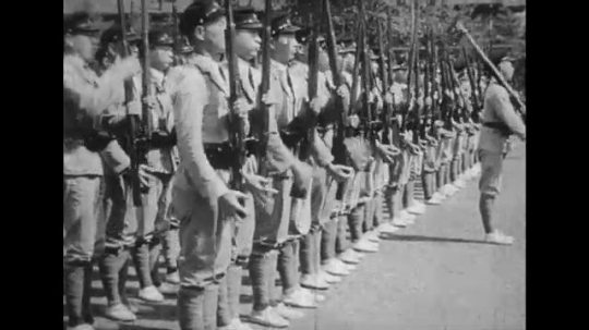 JAPAN: 1943: young men do drill with rifles. Close up of soldier