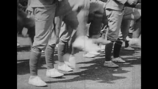JAPAN: 1943: close up of soldier's legs as they practice drill. Front view of soldiers at drill practice.