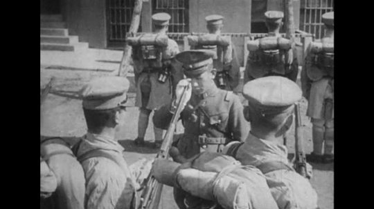 JAPAN: 1943: soldiers inspected by officer. Soldiers line up for inspection. Soldiers turn eyes front. Soldiers go to ground.