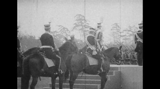 JAPAN: 1943: soldiers on horseback watch drill. Soldiers march.