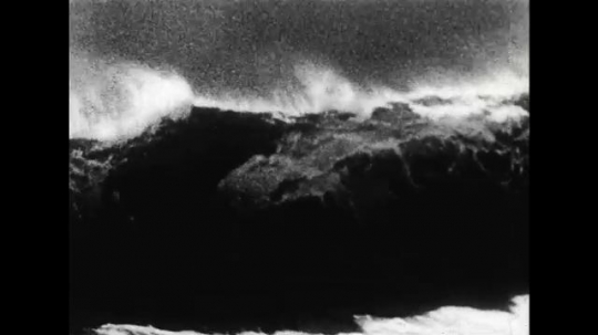ALASKA 1960s: A large wave crashes.