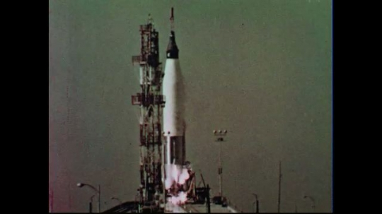 UNITED STATES 1950s:  A rocket takes off from a launch site.
