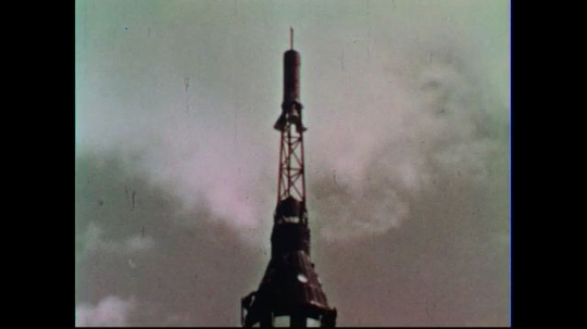 UNITED STATES 1950s:  The top of a rocket on a launch pad.  A small scale replica of an astronaut on top of a platform, seated in a launch position.  The rocket launches from a launch pad.