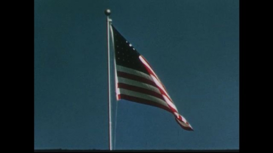 UNITED STATES 1950s: View of American flag / Close up of boy.