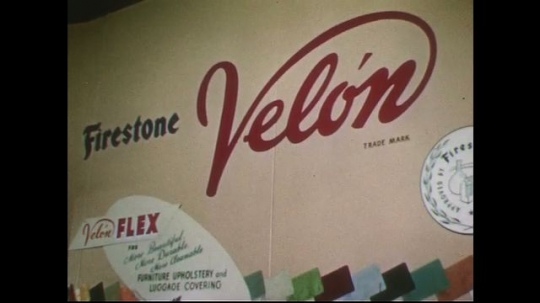 UNITED STATES 1950s: Pan of display of Firestone products / Pan of display of steel products.