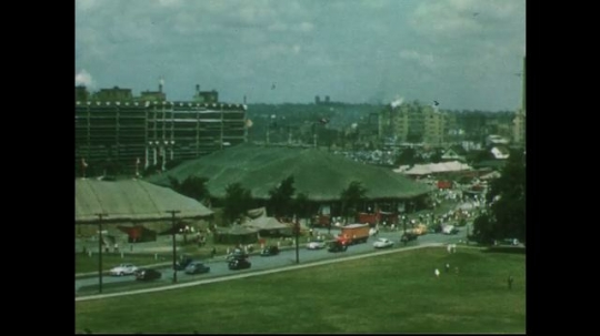 UNITED STATES 1950s: Long shot of circus tents, road / Closer view of circus tents.