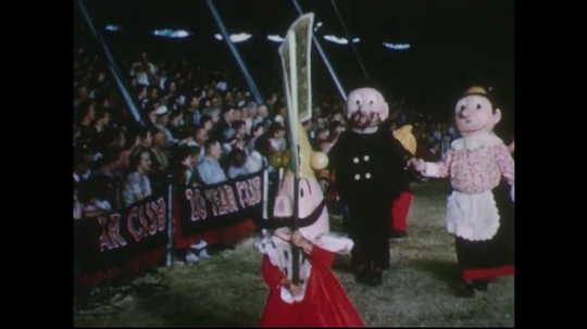 UNITED STATES 1950s: Performers dressed as cartoon characters at circus / Bears perform in circus ring.