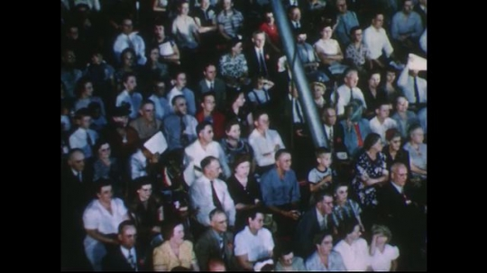 UNITED STATES 1950s: Pan of audience in stands at circus.