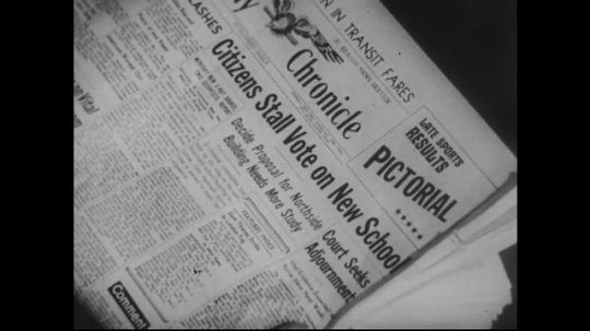 UNITED STATES 1950s: View of newspaper / Dissolve to text on paper, hands edit text.