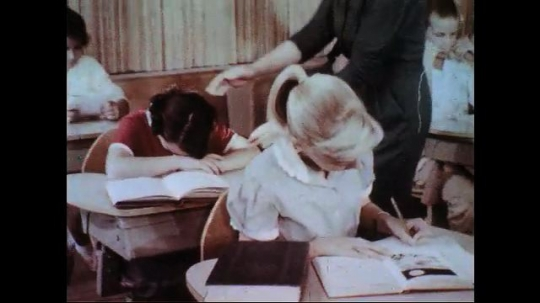 UNITED STATES 1950s-1960s : The teacher assists a sick girl to the nurse who takes her temperature.