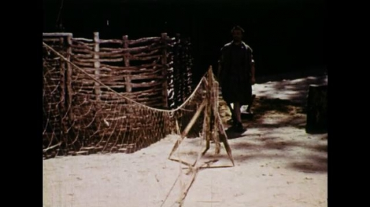 UNITED STATES 1600s: Colonial man looks at fishing net, walks off screen.