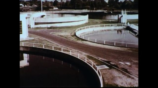 UNITED STATES 1950s: A treatment plant sterilizes waste leading to cleaner recreational areas like the beach.