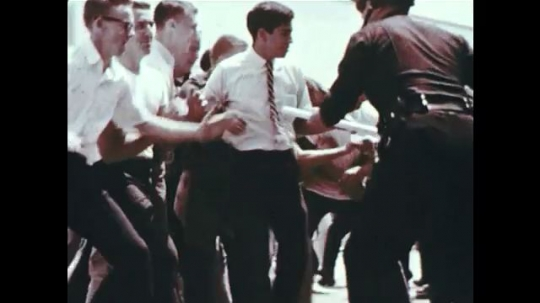 UNITED STATES 1960s: Police officers use their batons for offense, defense, and handling and restraining crowds.